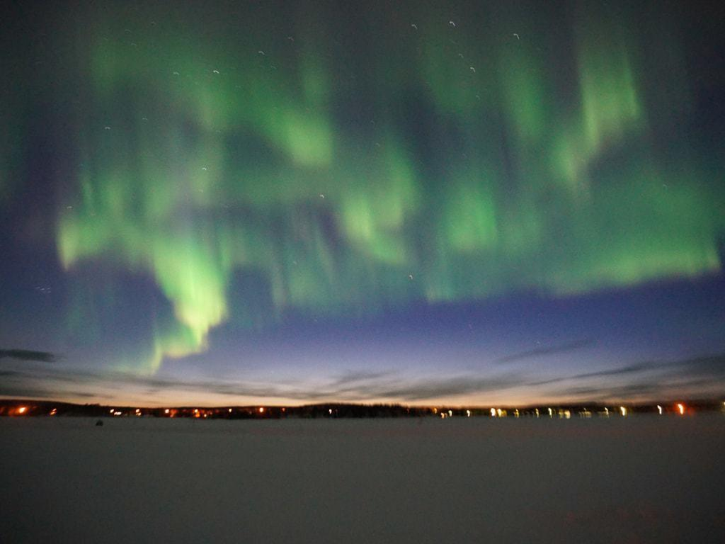 Northern Lights holidays in Finland: icy lakes are perfect spots to see Auroras!