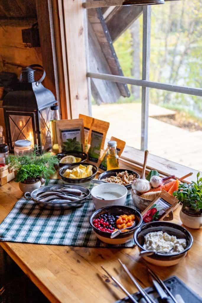 a variety of Finnish lunch foods spread across a table