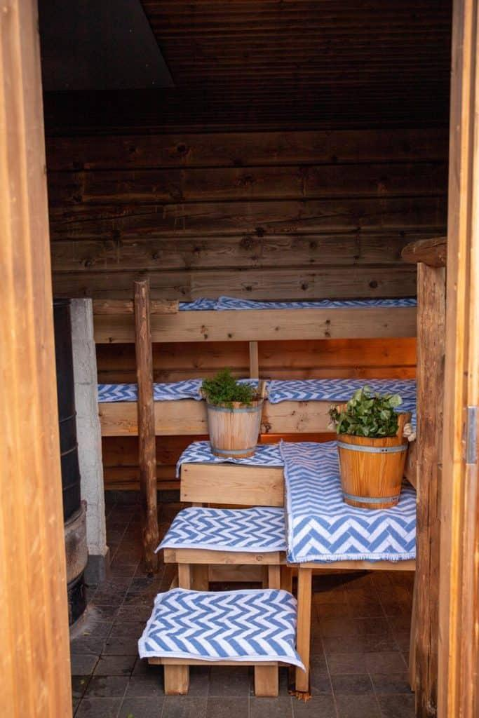 inside of a sauna with plants and cloths