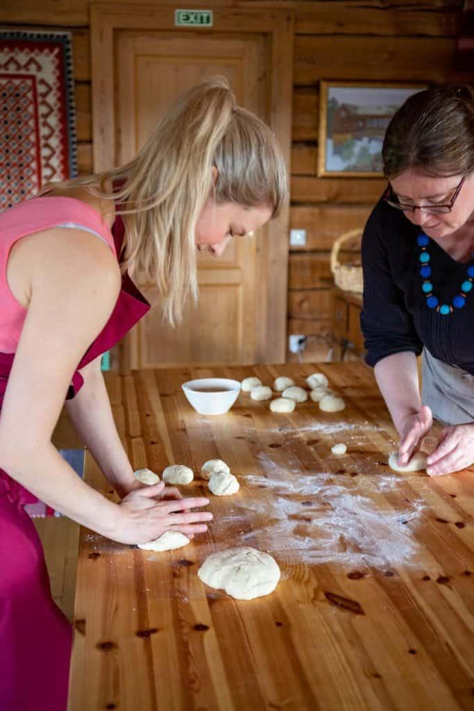 2 women preparing dough for baking